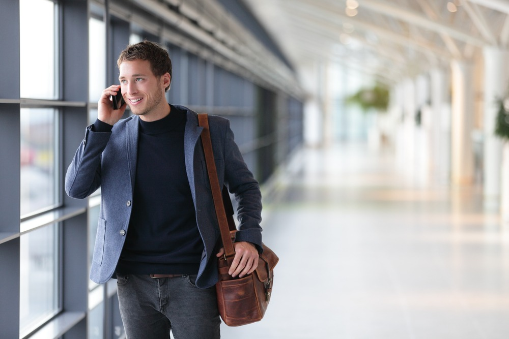 Urban businessman airport smartphone webcallback